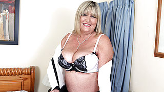 Big breasted British mature lady playing with her toy