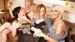 Four old and young lesbians have fun on the couch