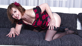 Naughty mature lady playing on her couch