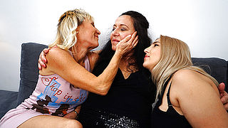 Three mature lesbians go at it on the couch