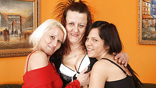 Two mature lesbians share a hot babe