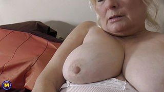 Busty granny feeding her old cunt
