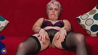 Stylish granny fingering her hungry vagina