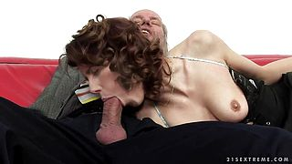 A cute redhead fingers an old mans ass hole