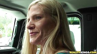 Mature blondie sucks throbbing penis in a car