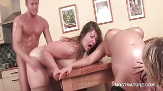 Mature bitch pussy fucked hard over the table