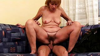 Mature housewife blowing young cock