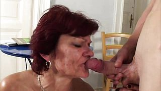 Mature redheaded milf sucks dick