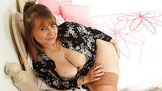 Curvy British housewife playing with her big tits and pussy