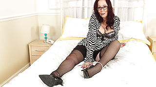 Horny British mature lsut playing with her toy